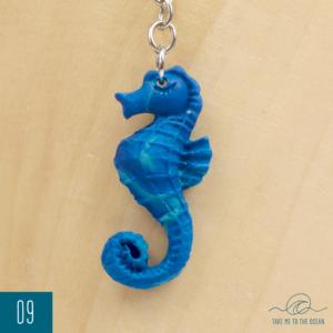 Blue-green seahorse resin keychain